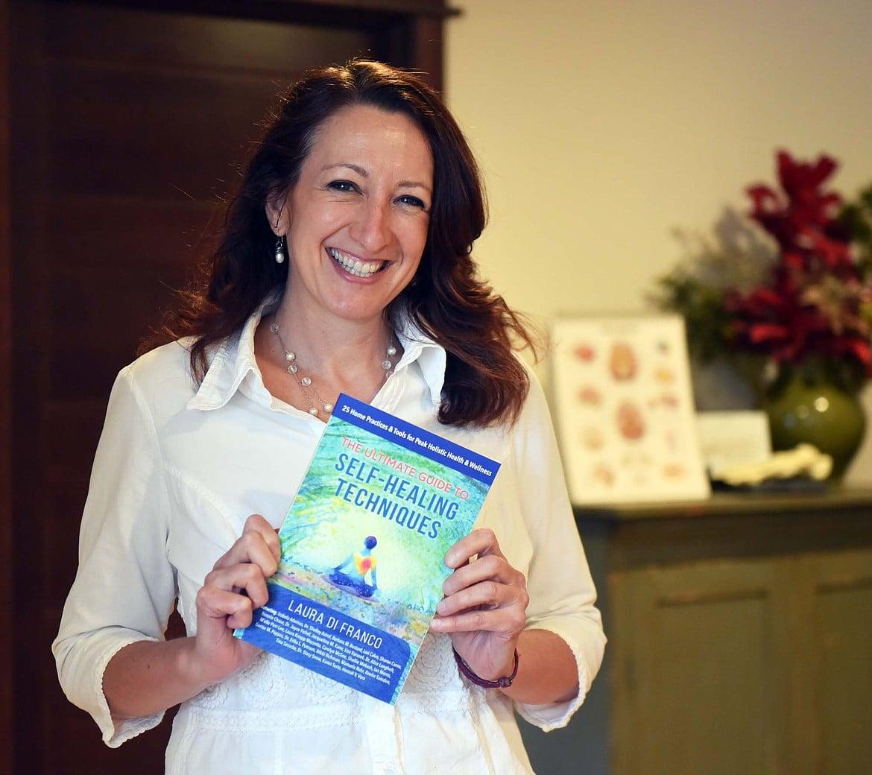 Dr. Erika Putnam Holding Book
